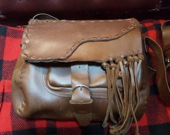 Vtg   Brown Leather Handcrafted Hippie Bag With Fringe Buckle Closure Front Pocket Shoulder Strap Measures 15x11
