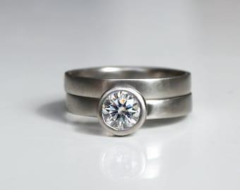 Forever One moissanite engagement ring set; palladium moissanite ring set