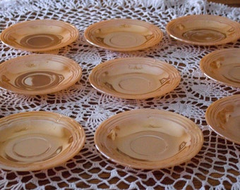 Set of  10 -  3 BANDS Saucers by Anchor Hocking PEACH LUSTRE in the Fire King Oven Ware Line