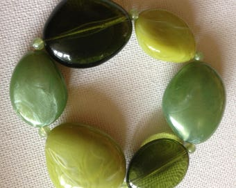Bracelet-  in sage green and lime green marbled and transparent plastic pebble shaped bead necklace retro design