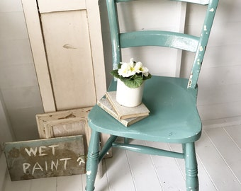 A 1930's painted kitchen chair
