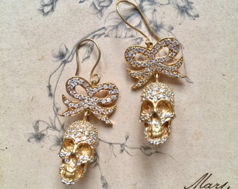 Pave crystal and bronze skull and bow earrings