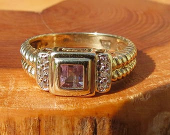 A fine vintage 9k yellow gold, iolite and diamond ring