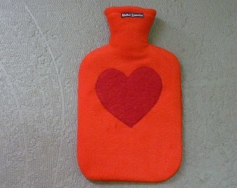 Red cuddly hot water bottle with red heart