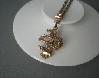 Modernist golden bronze necklace, Finland, 1970s.