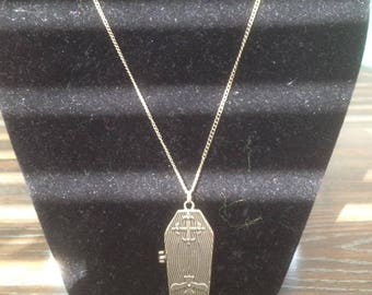 Skeleton coffin necklace