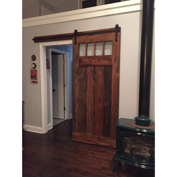 Spanish Colonial Design Glass Sliding Barn Door By Rustic Luxe