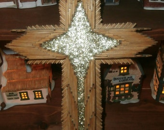 Vintage tramp art wood cross hand made with silver glittered star of Bethleham in the middle in 12 x 8 inches made with wooden match sticks