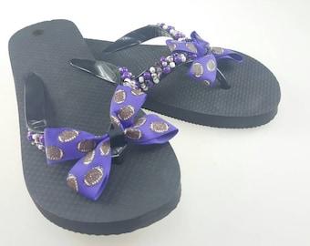 Womens purple football flip flops