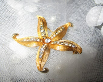 """vintage goldtone starfish brooch lines of small clear stones 2""""across"""