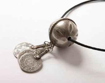 Large silver Berber bead with old silver coin dangles