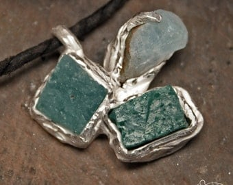 Silver pendant with two ancient mosaic tiles and one aquamarine's crystal