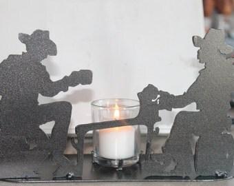 Metal cowboy candle holder