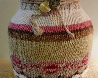 Multi color, two button accent vase.