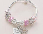 Personalised Bracelet with a selection of pink and silver charm beads and Engraved Heart Charm. European Style Bracelet.