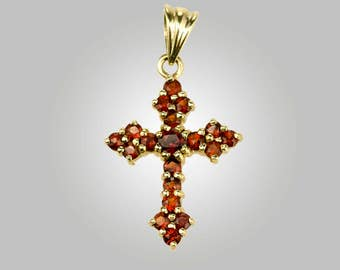 10k gold cross pendant set with 16 garnets