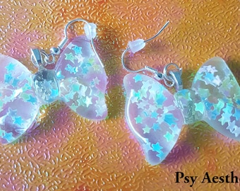 Star glitter bow earrings