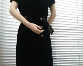 1950s, mid century black velvet, wrap over style dress with press stud fastening and decorative rhinestone buttons