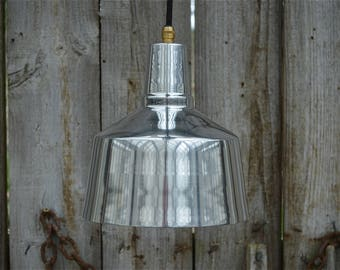 Cool retro styled Modernist hanging light made from polished aluminium with brass E27 bulb holder CME27