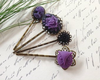 A Set of 4 Purple And Black Rose Hair Clips
