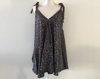 Ladies stunning short silk dress. Loose fitting with adjustable straps. One size.