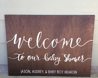 "Custom hand lettered ""welcome"" sign"