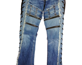 A pair of Vintage Blue Jeans with extra Zippers, back pockets & side lace up