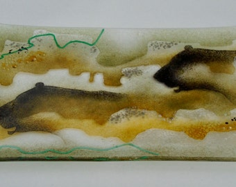 Evocative 'cave art' fused glass platter