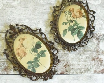 Pair of vintage satin rose cameo pictures in ornate frames.