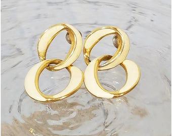 Cream enamel interlocking circles gold tone earrings