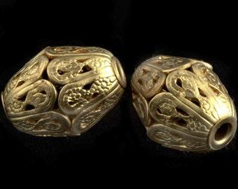 Brass filigree oval bead. 10x14mm. Pkg of 1. b18-0144(e)