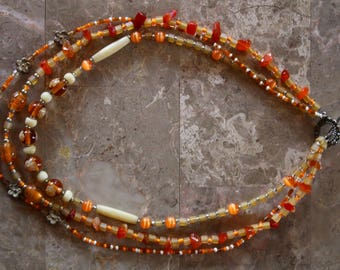 Peach triple strand necklace