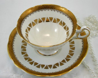 Vintage,Elegant, EB Foley, Footed Teacup & Saucer, Gilded Pattern on White Borders, Bone English China made in 1950s.