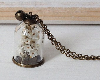 Necklace with glass dome and flowers