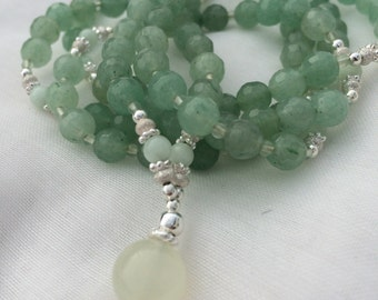 Mala of faceted green Aventurine and Amazonite with a keystone of serpentine