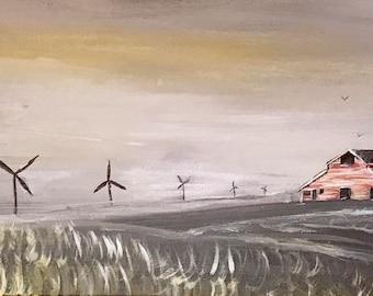 Barn in wheat field with windmills