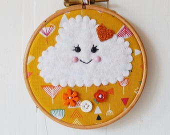 """Hand sewn embroidery hoop art, 10cm (4"""") wooden embroidery hoop, happy felt cloud on a fabric background with co ordinating buttons"""