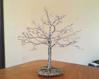 Wire and stone tree sculpture
