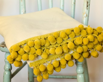 Decorative blanket / Throw with Pompoms.
