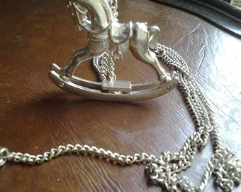Silver Coloured Rocking Horse Pendant on silver coloured chain