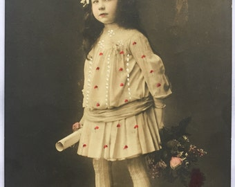 Fierce looking little girl * Antique Dress with hand painted polka dots * Schoolgirl holding diploma * Antique postcard early 1900s