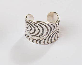 unisex ring crafted in sterling silver with texture