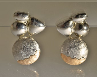 "Silver and gold earrings, with glossy and scratched items-collection ""Sunsets"""