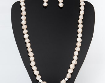 Beige, long necklace.