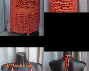 Orange cotton knit dress with needles and crochet