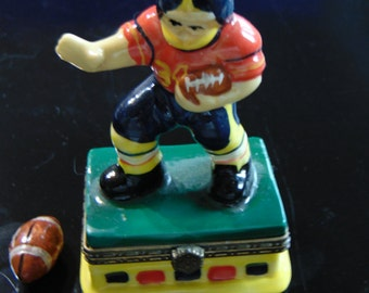 Football player with a foot ball trinket