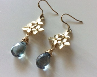 Gold plated cherry blossom dangle earrings with wire wrapped blue-green mystic quartz briolettes.