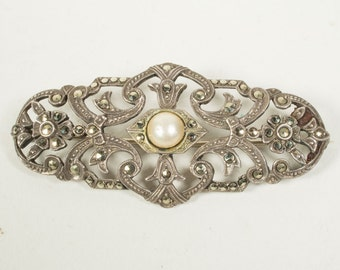 Silver Art Deco brooch with marcasite and a small faux pearl, Netherlands, 1930s