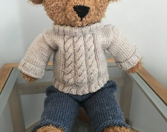 Hand knit teddy bear with hand knit outfit