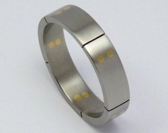 Titanium gold ring, weddingring, engagementring.